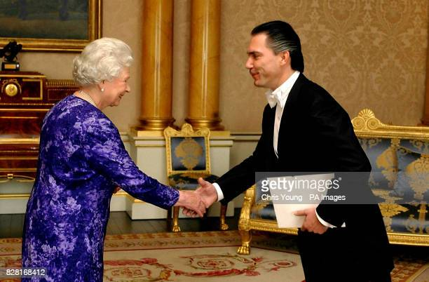 Britain's Queen Elizabeth II greets the Ambassador of Nicaragua Mr Piero Paolo Coen Ubilla at Buckingham Palace in central London Tuesday October 11...