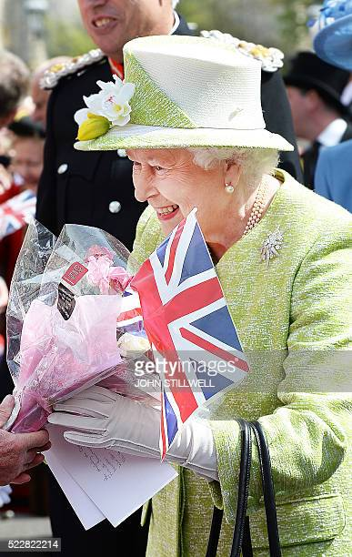 Britain's Queen Elizabeth II greets wellwishers during a 'walkabout' on her 90th birthday in Windsor west of London on April 21 2016 Britain...
