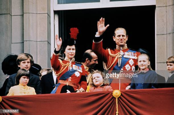 Britain's Queen Elizabeth II , her husband Prince Philip, Duke of Edinburgh and members of the Royal Family wave to the crowd on June 3, 1972 from...