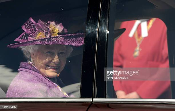 Britain's Queen Elizabeth II holds flowers as she leaves an Easter Sunday church service in Windsor on April 4 2019 AFP PHOTO / BEN STANSALL / WPA...