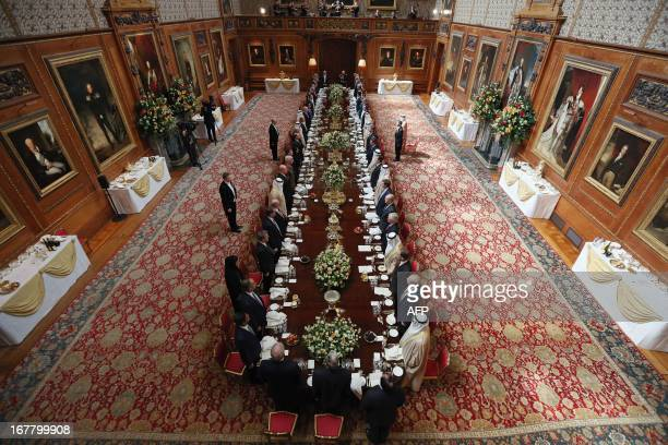 Britain's Queen Elizabeth II hosts a a State Luncheon on the first day of the state visit of Emirati President Sheikh Khalifa bin Zayed alNahayan in...