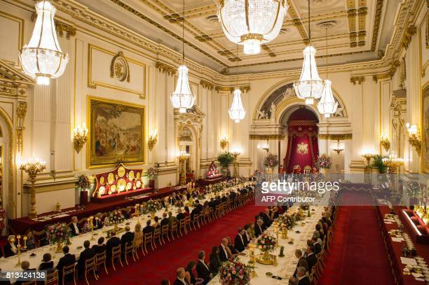 Britain's Queen Elizabeth II hosts Spanish King Felipe VI and Spanish Queen Letizia during a State Banquet in the ballroom at Buckingham Palace in...