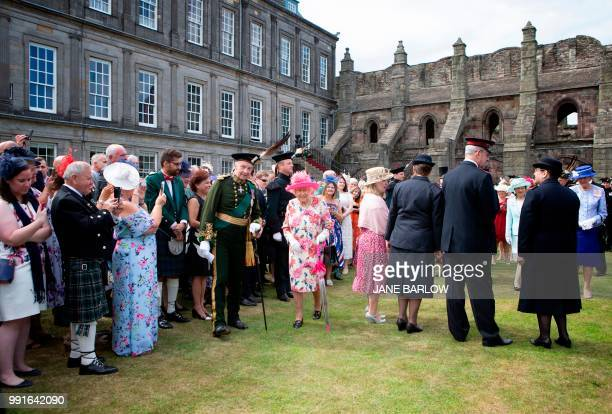 Britain's Queen Elizabeth II hosts the annual garden party at the Palace of Holyroodhouse in Edinburgh on July 4 2018