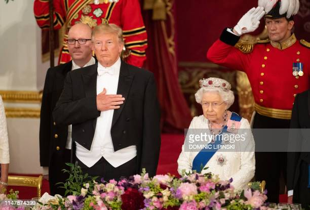 Britain's Queen Elizabeth II hosts US President Donald Trump and the US First Lady for a State Banquet in the ballroom at Buckingham Palace in...