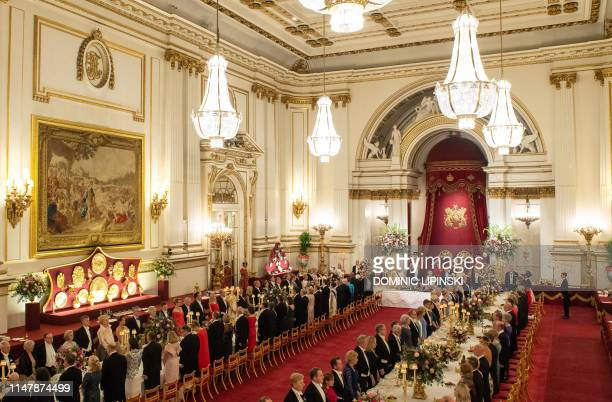 Britain's Queen Elizabeth II hosts US President Donald Trump and US First Lady Melania Trump for a State Banquet in the ballroom at Buckingham Palace...