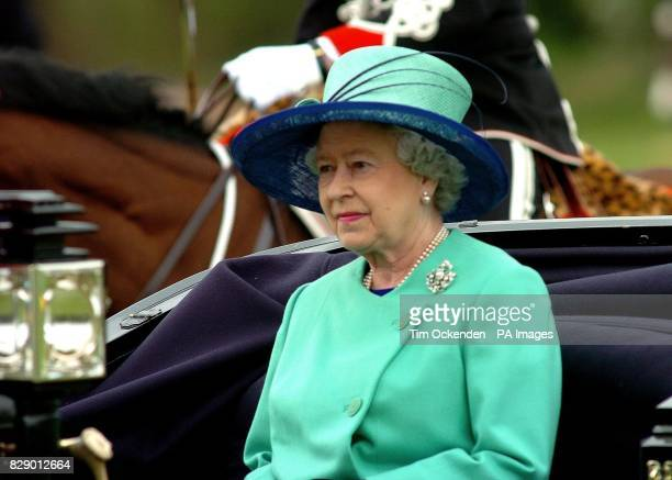 Britain's Queen Elizabeth II in a horse drawn carriage at Windsor Great Park The Queen today followed in the footsteps of Henry VIII as she paid a...