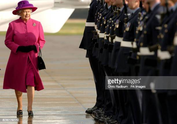 Britain's Queen Elizabeth II inspects the guard of honour at RAF Coltishall during a visit to the airbase in Norfolk, Thursday November 17 2005,...