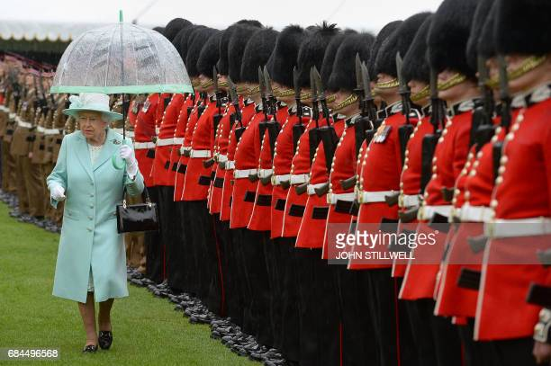 Britain's Queen Elizabeth II inspects the Regiment during a ceremony to present new colours to the 1st Battalion and F Company Scots Guards at...