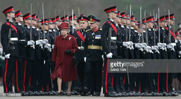 Britain's Queen Elizabeth II inspects the Sovereign's parade including her grandson Prince William at the Royal Military Academy Sandhurst in...