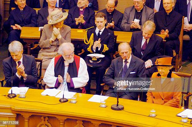 Britain's Queen Elizabeth II is applauded by the Archbishop of Canterbury Dr Rowan Williams and Prince Philip Duke of Edinburgh after having...