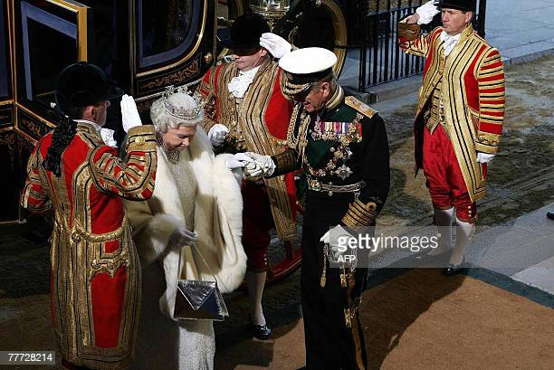 Britain's Queen Elizabeth II is assisted by the Duke of Edinburgh as she arrives at the Soverign Entrance of the House of Lords, in Westminster, in...