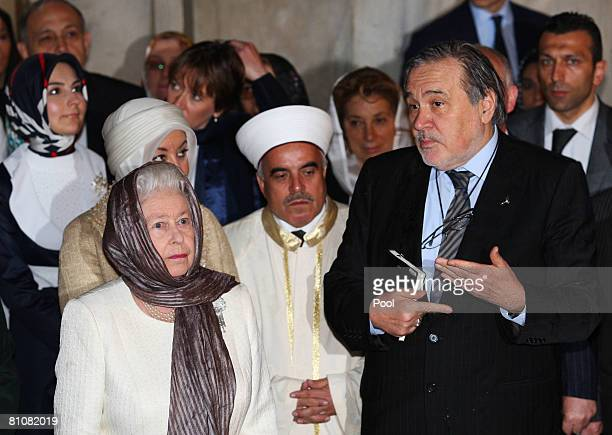 Britain's Queen Elizabeth II is briefed by Ilber Ortayli head of Topkapi Museum as they tour the Green Mosque in Turkey's northwest city of Bursa on...