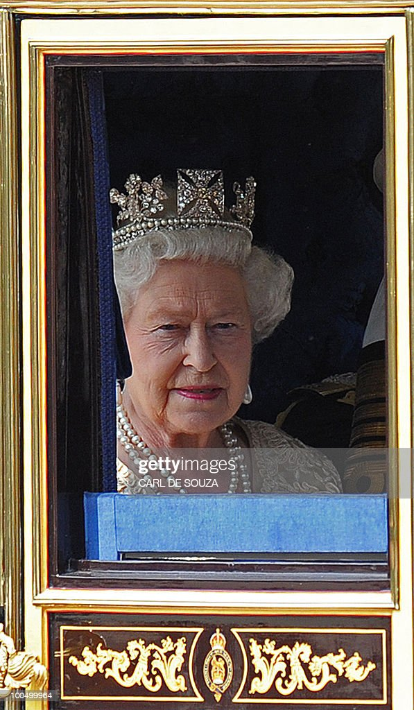 Britain's Queen Elizabeth II, is driven in a horse drawn carriage, the Houses of Parliament, for the State Opening of Parliament, in central London on May 25, 2010. Britain's Queen Elizabeth II set out the new coalition government's legislative programme on Tuesday in a ceremony of pomp and history following the closest general election for decades.