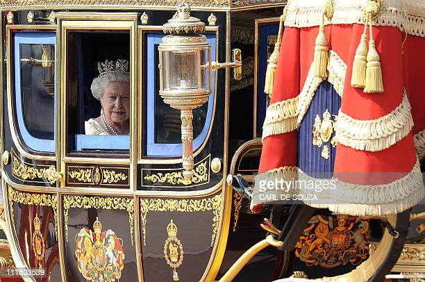 Britain's Queen Elizabeth II is driven in a horse drawn carriage to the Houses of Parliament for the State Opening of Parliament in central London on...