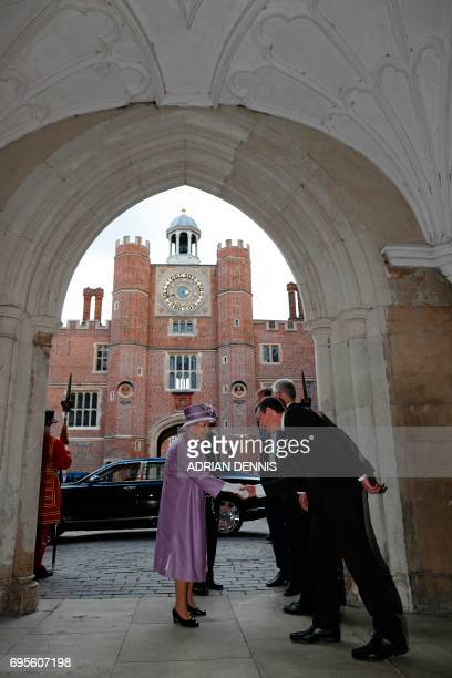 Britain's Queen Elizabeth II is greeted as she arrives to attend Evensong in celebration of the centenary of the Order of the Companions of Honour at...