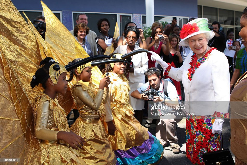 Britainu0027s Queen Elizabeth II is greeted by children dressed in carnival costumes at The Queens Centre  sc 1 st  Getty Images & Britainu0027s Queen Elizabeth II is greeted by children dressed in ...