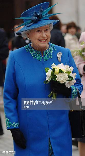 Britain's Queen Elizabeth II is greeted by crowds during a visit to the BBC's Broadcasting House in London on the day before her 80th birthday 20...