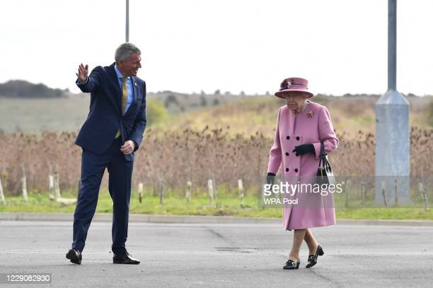 Britain's Queen Elizabeth II is greeted by Dstl Chief Executive Gary Aitkenhead as she arrives at the Energetics Analysis Centre as they visit the...