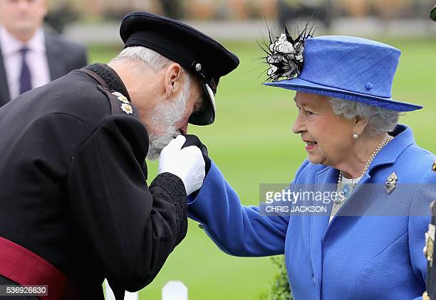 Britain's Queen Elizabeth II is greeted by Prince Michael of Kent during a visit to the Honourable Artillery Company in London on June 1 2016 The...