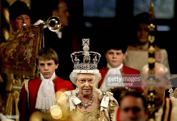 Britain's Queen Elizabeth II is heralded into the Royal Gallery in the House of Lords at the Palace of Westminster, during the State Opening of...