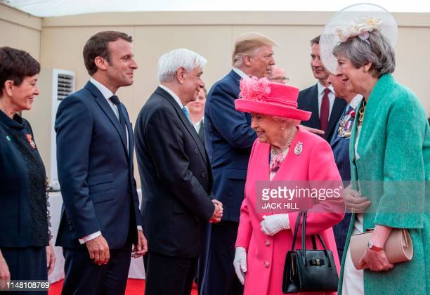 Britain's Queen Elizabeth II is presented by Britain's Prime Minister Theresa May to New Zealand's GovernorGeneral Patsy Reddy French President...