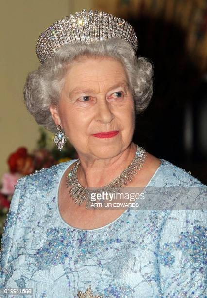 Britain's Queen Elizabeth II is seen late 19 February 2002 before a banquet that she hosted in Kingston with Governor General Sir Howard Cooke, her...