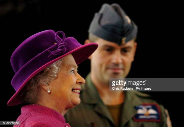 Britain's Queen Elizabeth II is shown around RAF Coltishall by Flight Lt Jason Beddall during a visit to the airbase in Norfolk, Thursday November 17...