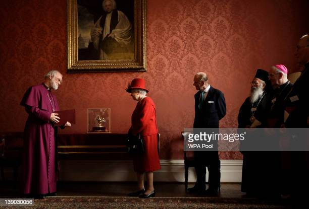 Britain's Queen Elizabeth II is shown the Ampulla and Coronation Spoon which was used at her Coronation in 1953 by the Archbishop of Canterbury Rowan...