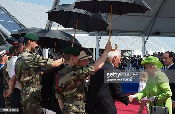 Britain's Queen Elizabeth II is welcomed at a ceremony as part of the events marking the 70th anniversary of the World War II Allied landings in...