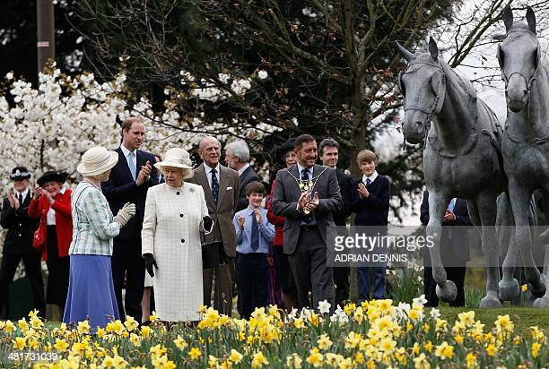Britain's Queen Elizabeth II joined by Britain's Prince Philip Duke of Edinburgh and Britain's Prince William Duke of Cambridge officially unveil the...
