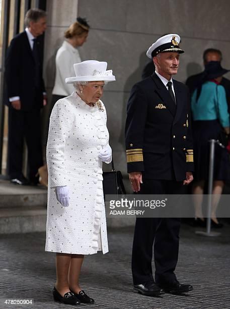 Britain's Queen Elizabeth II lays a wreath at the memorial for the victims of war and dictatorship in Berlin on June 24 2015 British Queen Elizabeth...