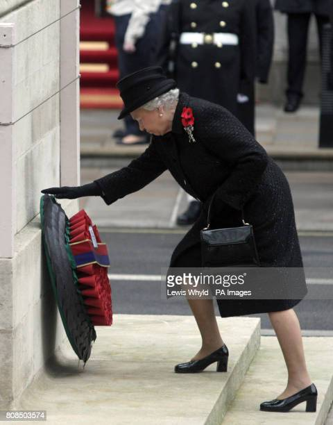 Britain's Queen Elizabeth II lays a wreath at the Remembrance Sunday ceremony at the Cenotaph Whitehall London