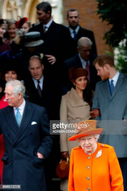 Britain's Queen Elizabeth II leads out the Royal Family as they leave after attending their traditional Christmas Day church service at St Mary...