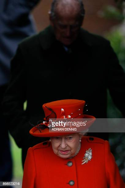 Britain's Queen Elizabeth II leads out the Royal Family including Britain's Prince Philip Duke of Edinburgh as they leave after attending their...
