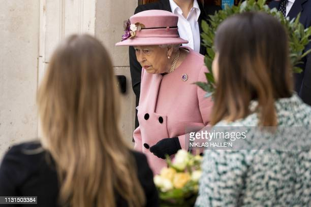 Britain's Queen Elizabeth II leaves after a visit to Kings College to open Bush House the latest education and learning facilities on the Strand...
