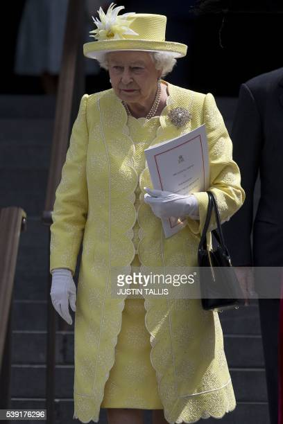 Britain's Queen Elizabeth II leaves after attending a national service of thanksgiving for her 90th birthday at St Paul's Cathedral in London on June...