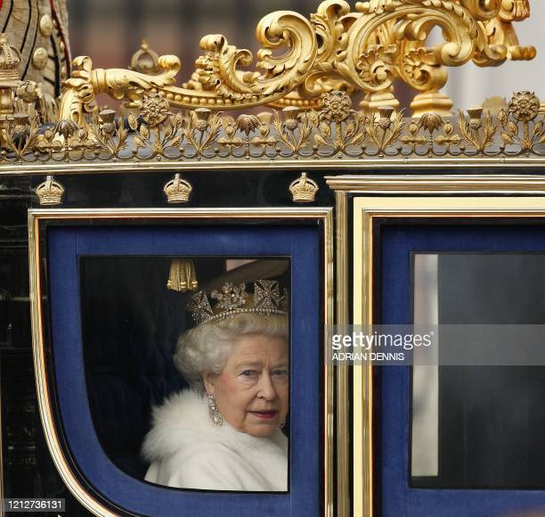 Britain's Queen Elizabeth II leaves Buckingham Palace en route to The Palace of Westminster for the State Opening of Parliament, in London, on...