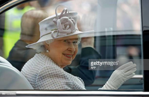Britain's Queen Elizabeth II leaves following her tour of Priory View an independent living scheme for older residents in Dunstable northwest of...