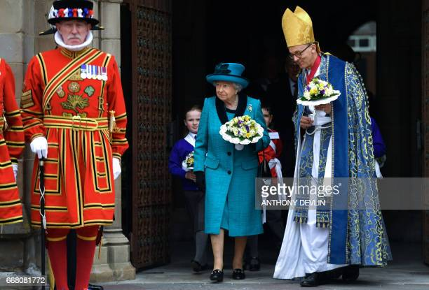 Britain's Queen Elizabeth II leaves following the Royal Maundy service at Leicester Cathedral on April 13 2017 in Leicester / AFP PHOTO / POOL /...