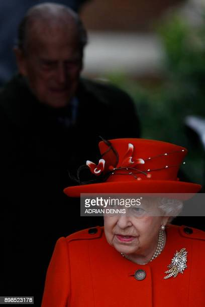 Britain's Queen Elizabeth II leaves in front of Britain's Prince Philip Duke of Edinburgh after attending Royal Family's traditional Christmas Day...