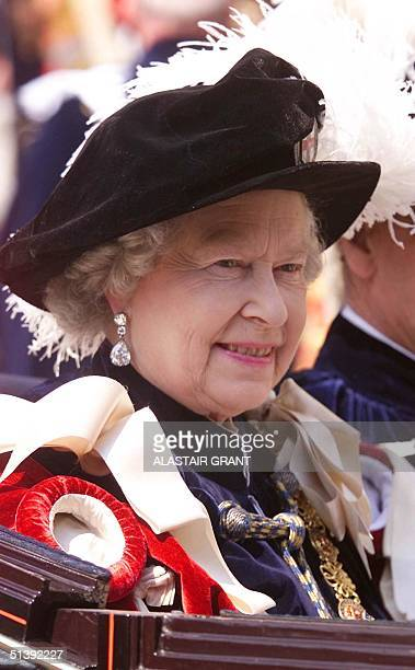 Britain's Queen Elizabeth II leaves the annual Garter ceremony by carridge at Windsor Castle Monday 18 June 2001 The Most Nobel Order of the Garter...