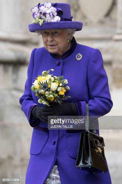 Britain's Queen Elizabeth II leaves Westminster Abbey in central London on November 24 after attending a Service of Thanksgiving to celebrate 60...