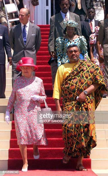 Britain's Queen Elizabeth II leaves with Ghanian President Jerry Rawlings his wife Nana Kunadu and the Duke of Edinburgh the parliament 08 November...