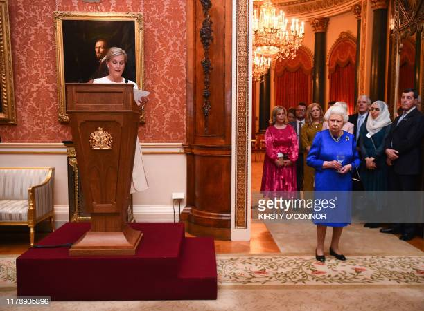 Britain's Queen Elizabeth II listens as Britain's Sophie, Countess of Wessex, delivers a speech at a reception at Buckingham Palace in London on...
