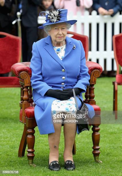 Britain's Queen Elizabeth II listens to a speech during a visit to the Honourable Artillery Company in London on June 1 2016 The engagement marks the...