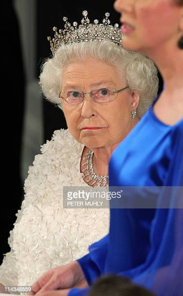 Britain's Queen Elizabeth II listens to Irish President Mary MaAleese at a state dinner in Saint Patrick's Hall at Dublin Castle in Dublin on May 18...