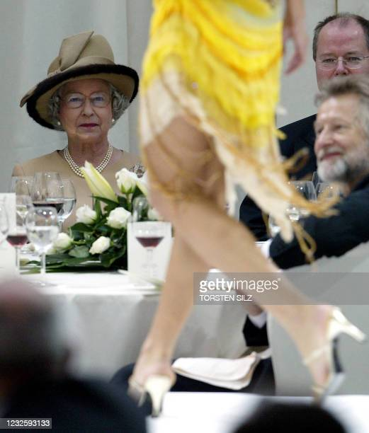 Britain's Queen Elizabeth II looks at a fashion show at the Staendehaus in Duesseldorf 04 November 2004. The queen is on the last of a three-day...