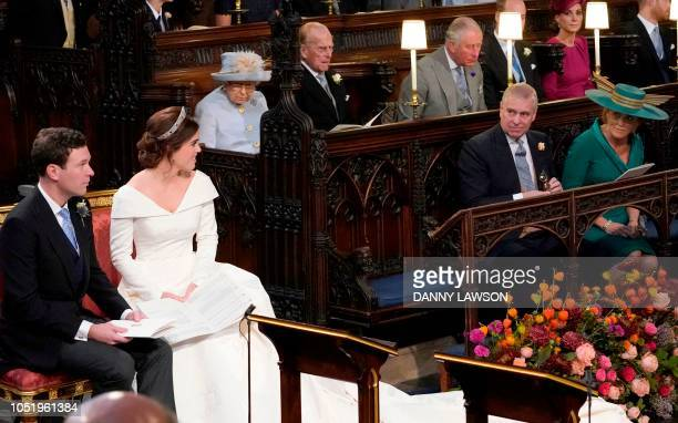 Britain's Queen Elizabeth II looks on as Britain's Princess Eugenie of York and Jack Brooksbank look towards her parents Britain's Prince Andrew Duke...