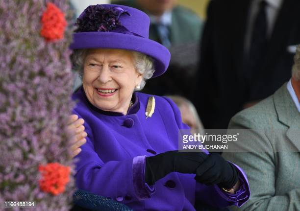 Britain's Queen Elizabeth II looks on during the annual Braemar Gathering in Braemar central Scotland on September 7 2019 The Braemar Gathering is a...