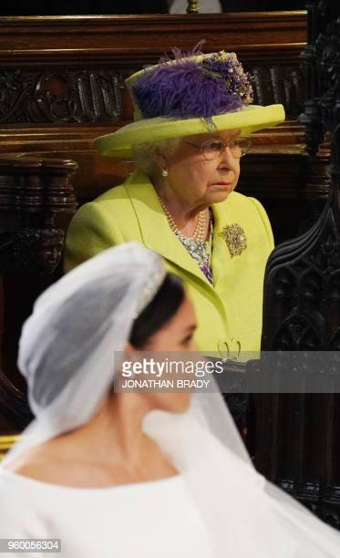Britain's Queen Elizabeth II looks on during the wedding ceremony of Britain's Prince Harry Duke of Sussex and US actress Meghan Markle in St...